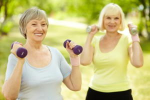 Ladies exercising outside with arm weights